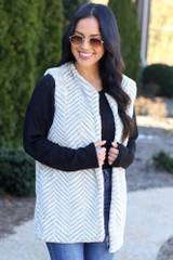Model wearing the Chevron Faux Fur Vest with high rise jeans Front View