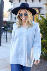 Model wearing the Brushed Knit Oversized Sweater in Heather Grey with medium wash jeans from Dress Up Front View
