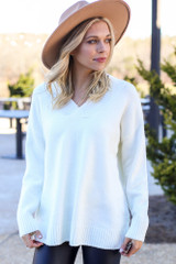 Model wearing the Brushed Knit Oversized Sweater in Ivory with wide brim hat and high rise jeans from Dress Up Front View