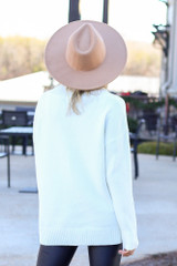 Model wearing the Brushed Knit Oversized Sweater in Ivory with wide brim hat from Dress Up Back View