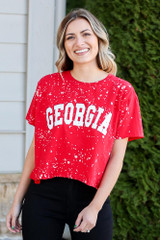 Model wearing the Red Georgia Acid Washed Graphic Tee from Dress Up in Large with black skinny jeans Front View