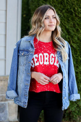 Model wearing the Red Georgia Acid Washed Graphic Tee from Dress Up in Large with denim jacket black skinny jeans Front View