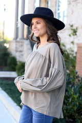 Model wearing the Balloon Sleeve Babydoll Top in Taupe Side View