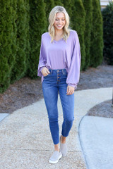 Model wearing the High-Rise Button Front Skinny Jeans in Medium Wash