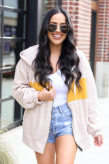 Model wearing the Sherpa Teddy Zip Up Hoodie Jacket in Taupe with denim shorts