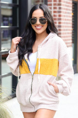 Dress Up model wearing the Sherpa Teddy Zip Up Hoodie Jacket in Taupe with sunglasses