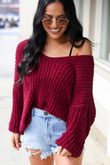Close up of a Dress Up model wearing the Oversized Chenille Sweater in Burgundy with denim shorts
