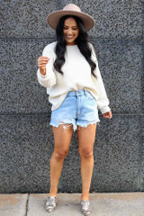 Model wearing the Ribbed Knit Oversized Top in Ivory with high rise denim shorts and wide brim fedora Full Outfit View