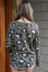 Model wearing Olive Brushed Knit Leopard Top with denim shorts Back View