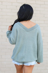 Model wearing the Oversized Waffle Knit Contrast Top in Sage Back View
