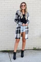 Model wearing the Buffalo Plaid Longline Cardigan in Ivory