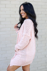 Model wearing the Popcorn Knit Sweater Cardigan in Blush from Dress Up Side View