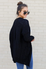 Model wearing the Popcorn Knit Sweater Cardigan in Black from Dress Up Side View