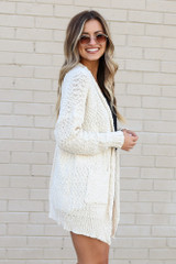 Model wearing the Popcorn Knit Sweater Cardigan in Ivory from Dress Up Side View