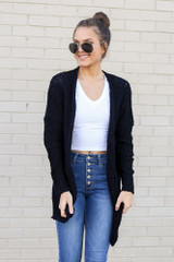 Model wearing the Popcorn Knit Sweater Cardigan in Black with high rise jeans and white basic tee from Dress Up Front View