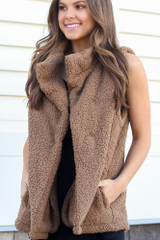 Close up of a model wearing the Sherpa Vest in Mocha