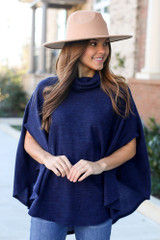 Navy - Brushed Knit Cowl Neck Oversized Poncho from Dress Up Boutique. Wearing a wide brim hat
