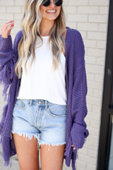 Model wearing the Fringe Knit Longline Cardigan in Purple