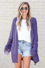 Dress Up model wearing the Fringe Knit Longline Cardigan in Purple with denim shorts