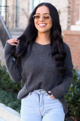 Model wearing the Plush Knit Sweater in Grey with light wash denim jeans