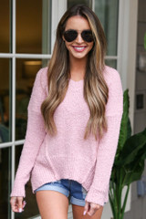 Dress Up model wearing the Plush Knit Sweater in Blush with denim shorts