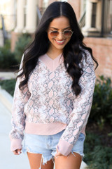 Dress Up model wearing the Luxe Knit Snakeskin Sweater in Blush with denim shorts