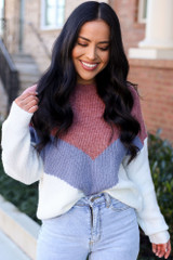 Model wearing the Color Block Sweater in Mauve with high rise jeans from Dress Up Front View