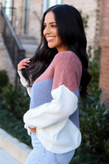 Model wearing the Color Block Sweater in Mauve with high rise jeans from Dress Up Side View