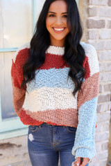 Model wearing the Striped Popcorn Knit Sweater in Blue tucked into medium wash denim jeans