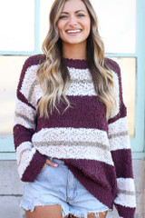 Model wearing the Striped Popcorn Knit Oversized Top in Burgundy with denim shorts Front View