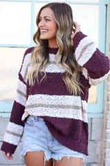 Model wearing the Striped Popcorn Knit Oversized Top in Burgundy with denim shorts from Dress Up Front View
