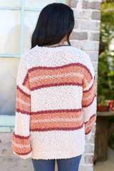 Model wearing the Striped Popcorn Knit Oversized Top in Natural with high rise jeans from Dress Up Back View