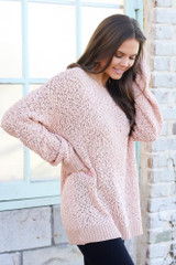Model wearing the Popcorn Knit Oversized Top in Blush with black skinny jeans from Dress Up Side View