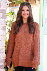 Model wearing the Popcorn Knit Oversized Top in Rust with black skinny jeans from Dress Up Boutique Front View