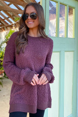 Model wearing the Popcorn Knit Oversized Top in Marsala with high rise skinny jeans from Dress Up Front View