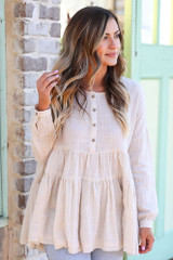 Ivory - Tiered Babydoll Tunic from Dress UpModel wearing the Ivory Tiered Babydoll Tunic with high rise jeans front view