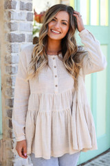 Model wearing the Ivory Tiered Babydoll Tunic with high rise jeans from Dress Up front view