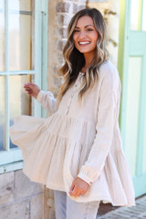 Ivory - Model wearing the Ivory Tiered Babydoll Tunic with high rise jeans from Dress Up Side view