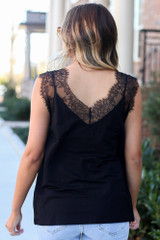 Model wearing the Black Lace Tank from Dress Up with high rise jeans Back View
