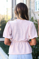 Model wearing the Blush Puff Sleeve Metallic Blouse from Dress Up Back View