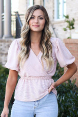 Model wearing the Blush Puff Sleeve Metallic Blouse with high rise jeans from Dress Up Front View
