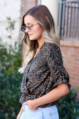 Model wearing the Draped Sleeve Leopard Blouse with high rise jeans and sunglasses from Dress Up Side View