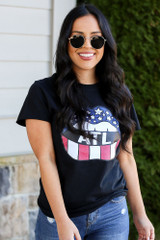 Model wearing the Atlanta Graphic Tee with high rise jeans from Dress Up