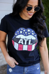 Model wearing the Atlanta Graphic Tee with high rise jeans from Dress Up Close Up View