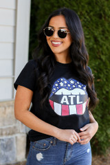 Model wearing the Atlanta Graphic Tee with high rise jeans from Dress Up Boutique Front View
