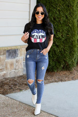 Model wearing the Atlanta Graphic Tee with high rise jeans from Dress Up Full Outfit View
