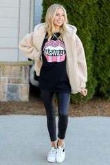 Model wearing the Black Nashville Graphic Tee in Large with leggings and sherpa jacket from Dress Up Full Outfit View
