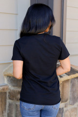 Model wearing the Black Nashville Graphic Tee in Small with high rise jeans from Dress Up Back View