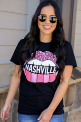 Model wearing the Black Nashville Graphic Tee in Small with high rise jeans from Dress Up