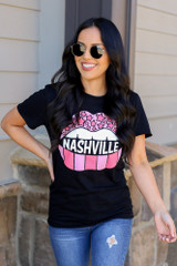 Model wearing the Black Nashville Graphic Tee in Small with high rise jeans from Dress Up Front View